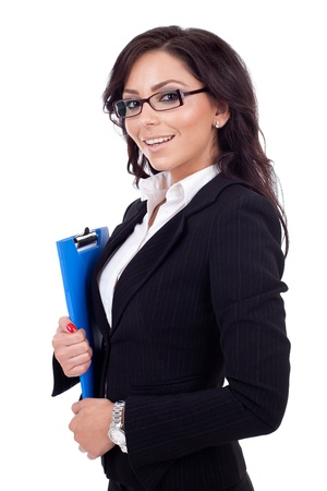 Portrait of a young confident business woman holding a clipboard photo