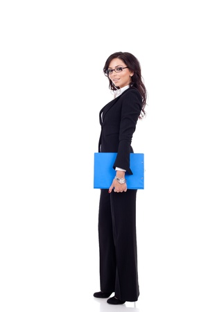 Full length of a business woman holding a clipboard photo