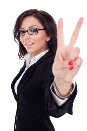 Portrait of happy beautiful business woman showing victory sign, isolated  photo