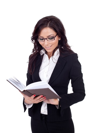attractive business woman reading a book, isolated photo