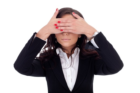Business woman holding her hand at her eyes photo