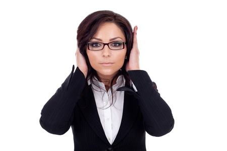 Woman covering her ears - Hear no evil , isolated on white background  photo