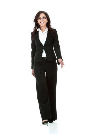 well dressed: picture of a young business woman walking towards the camera  Stock Photo