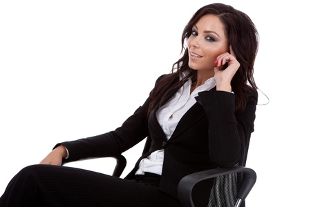 Business woman in a chair thinking and looking at the camera photo