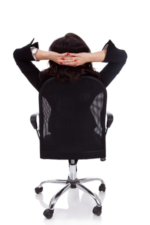 mani incrociate: Soddisfatti donna d'affari con le mani incrociate dietro la testa Archivio Fotografico