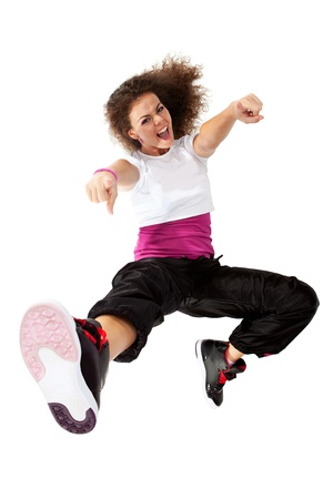 Teenage girl dancing hip-hop and pointing at the camera