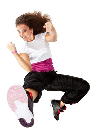 breakdance: young female dancer in a fight position, isolated Stock Photo