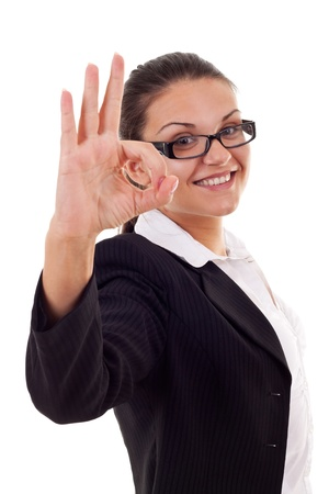 Young business woman indicating ok sign. Isolated over white background Stock Photo - 10092177