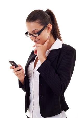 business woman sending a text message on her mobile phone - isolated over a white background photo