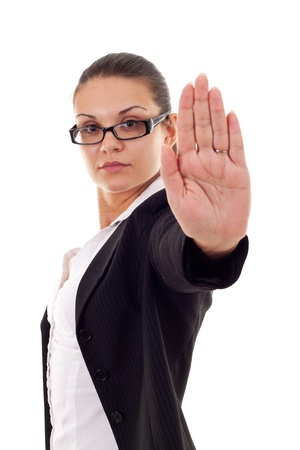 disclaim: Serious business woman making stop sign over white, focus on hand