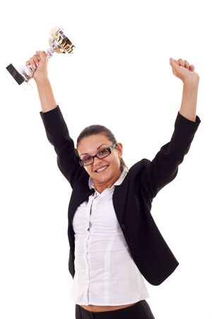 Portrait of an excited young business woman winning a trophy against white background  photo