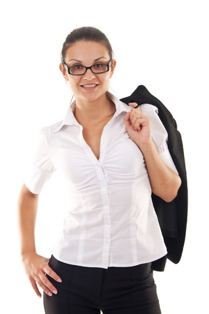 attractive business woman standing with coat over shoulder photo