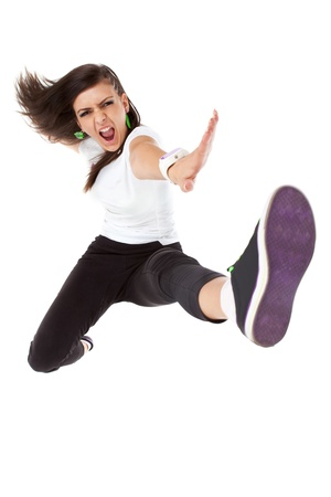 break dancer: Studio isolated. Dancing woman with brown long hair and happy smiling facial expression posing.