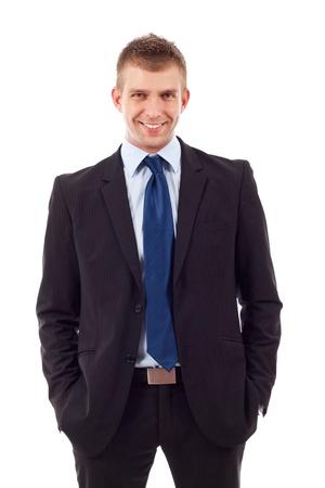 director de escuela: Hombre de negocios confidente moderna manteniendo las manos en los bolsillos del pantalón aislado en blanco Foto de archivo