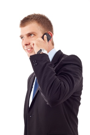 side view of a young business man talking on the mobile phone, isolated on white  photo