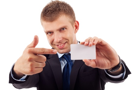 young attractive business man shows his business card Stock Photo - 10520962