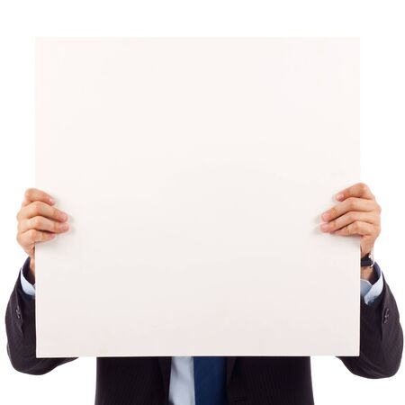 Young business man with blank board over his face isolated on white
