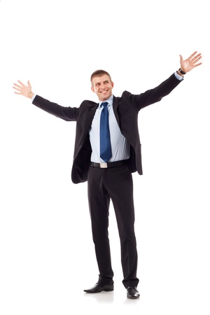 portrait of young, happy winner businessman with arms wide open over white photo