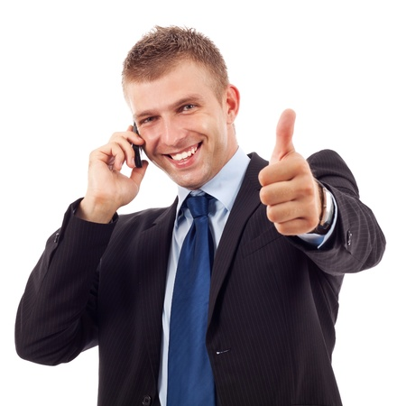 business man showing thumbs up while talking on the phone photo