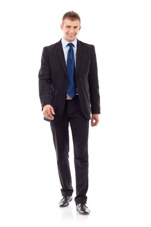 cuerpo entero: Retrato de cuerpo completo del hombre de negocios a pie, aisladas sobre fondo blanco