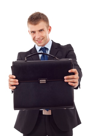 black briefcase: young business man offering a black briefcase over white  Stock Photo