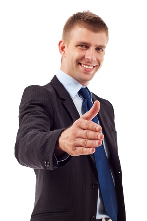 Business man saying welcome by giving the hand for shake, focus on hand Stock Photo - 10520918