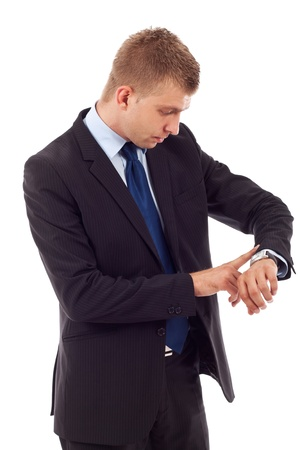 tardy: handsome business man checking his wrist-watch over white Stock Photo