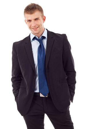 untied: empresario relajado de pie con sus manos en los bolsillos y corbata no ligada Foto de archivo