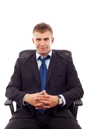 handsome business man sitting in office chair over white  Stock Photo