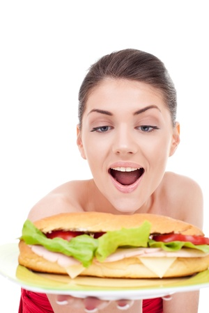 adult sandwich: amazed woman about a big crispy sandwich over white