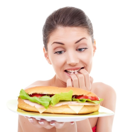 starve: pretty woman wondering whether or not to eat a sandwich
