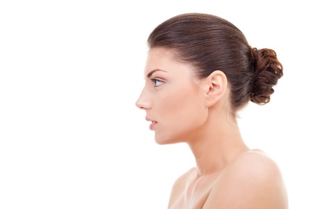 woman face profile: happy beautiful young woman is looking sideways isolated on white  Stock Photo