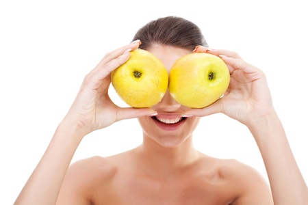 Closeup of gorgeous young woman holding apples over her eyes  photo