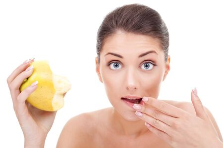 beautiful female portrait, holding a bitten apple and wiping her lips Stock Photo - 10521028