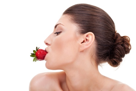 portrait of a nude sexy woman holding a red-ripe strawberry in her mouth. Stock Photo - 10521031