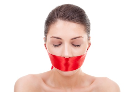 woman with closed eyes and mouth covered with a red ribbon over white background photo