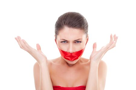 angry woman with  mouth covered with a red ribbon over white background photo