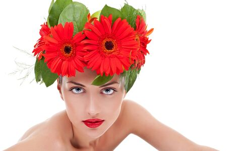 young beautiful woman wearing a gerbera wreath on her head and looking at the camera photo