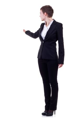 Business woman with her arm out in a welcoming or presenting gesture, isolated on white background Stock Photo - 10520819