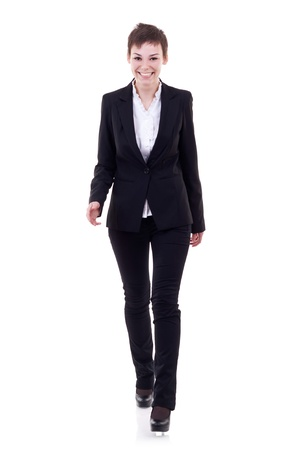 business woman standing: Business woman in black suit walking in full length on white background.