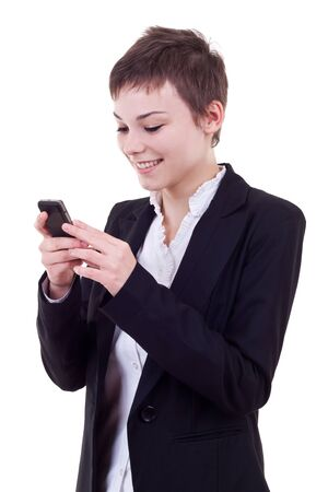 Portrait of a happy young business woman texting from her cellphone against white background photo