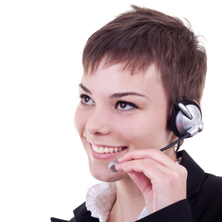 telephonist: Portrait of a happy young female customer representative with headset smiling during a telephone conversation