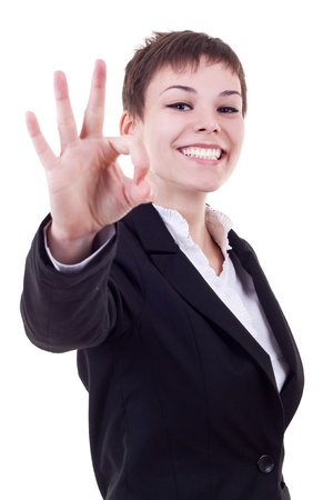 Attractive business woman satisfied with results - ok sign  Stock Photo - 10520902