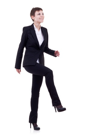 Young attractive business woman stepping on imaginary step Stock Photo - 10520820