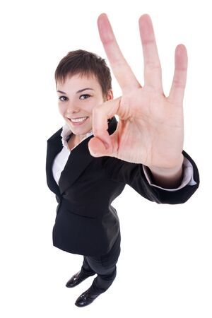 allright: wide angle picture of an attractive business woman satisfied with results - ok sign