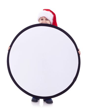 Boy holding a round poster isolated on white background  photo