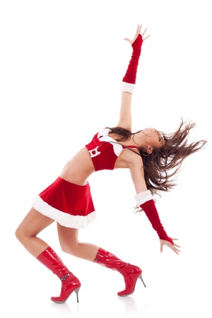 excited pinup dancing woman in Christmas outfit  photo