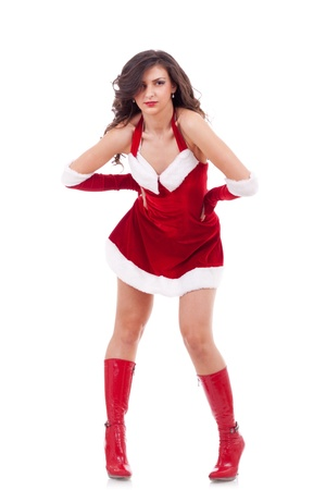 red gloves: studio portrait of a sexy young brunette woman dressed as Santa  Stock Photo