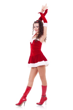 sexy woman dressed as Santa Claus on a white background photo