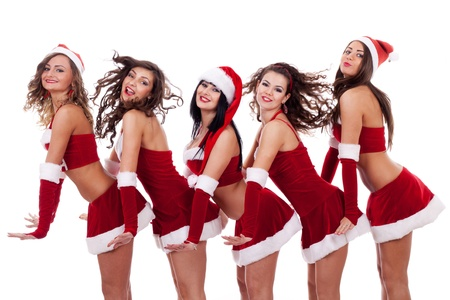 santa clause hat: playful group of young santa women on white background